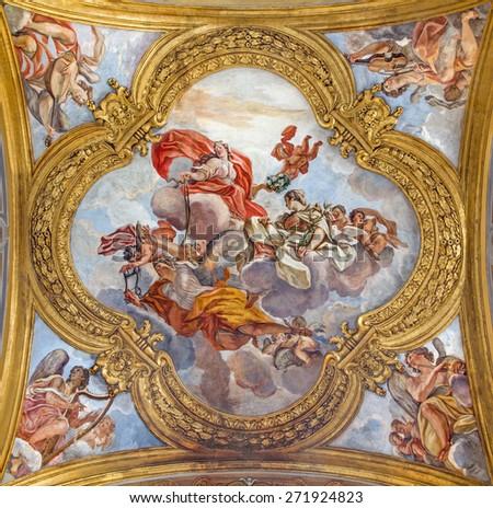 ROME, ITALY - MARCH 25, 2015: The fresco of virtues on the little cupola of side nave in church Basilica dei Santi Ambrogio e Carlo al Corso by Giacinto Brandi (1621 - 1691). - stock photo