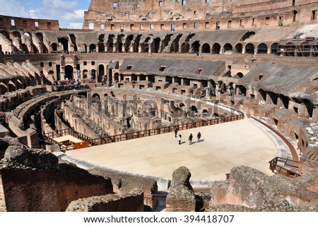 ROME, ITALY - MARCH 15, 2016: Tourists visiting the interior of the Colosseum, one of the New Seven Wonders of the World - stock photo