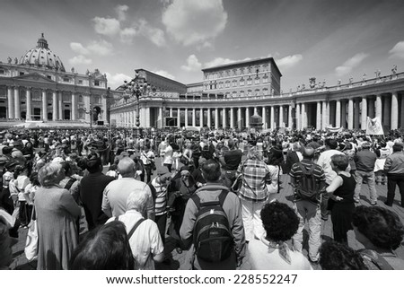 ROME, ITALY - MAY 9, 2010: Crowds of pilgrims pray at Saint Peter's Square in Vatican. Vatican is the Holy See of Roman Catholic Church and thus one of most important pilgrimage destinations. - stock photo