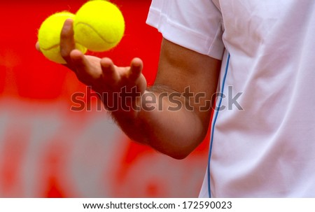 "ROME, ITALY - MAY 09: International Tennis tournament ""Internazionali d'Italia"" in Rome, May 09, 2006. A tennis player holding 2 tennis yellow balls. - stock photo"