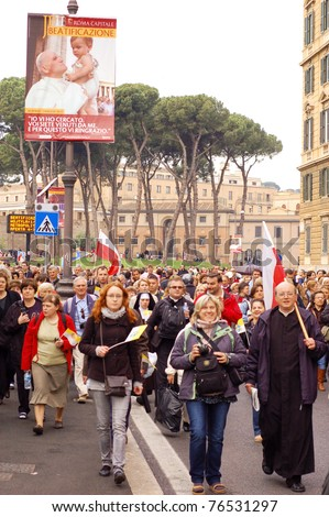 ROME, ITALY - MAY 1: People attending the beatification of Pope John Paul II in Rome, Italy on May 1, 2011. - stock photo