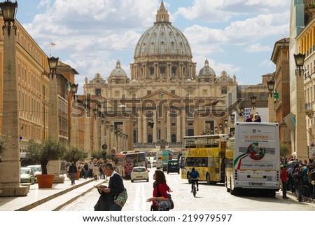 ROME, ITALY - MAY 03, 2014: People near the Basilica di San Pietro from the Via della Conciliazione. Vatican City, Italy - stock photo