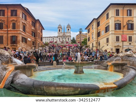 Rome, Italy - May 2, 2011: Spanish steps and Ugly Boat fountain surronded by hundreds of tourists with Trinita dei Monti church on background - stock photo