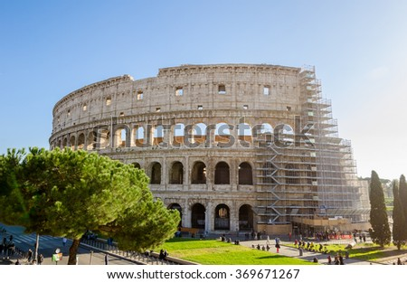 ROME, ITALY - 29 November 2015: Colosseum exterior with the scaffolding for restoration works and people walking near by this wonderful ancient monument - stock photo