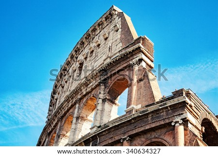 Rome, Italy - October 08, 2012: Part of Colosseum against blue sky - stock photo