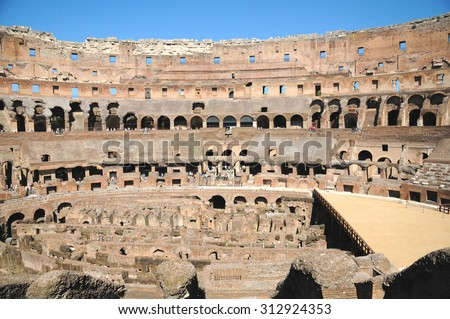 ROME, ITALY, SEP 13: People visiting inside of Colosseum in Rome, Italy. The Colosseum,a  Flavian Amphitheatre, is an elliptical amphitheatre in the centre of the city of Rome, Italy, SEP 13, 2009 - stock photo