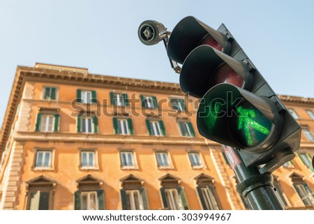 ROME, ITALY - SEPTEMBER 22, 2013 : View of a traffic light shows green. - stock photo