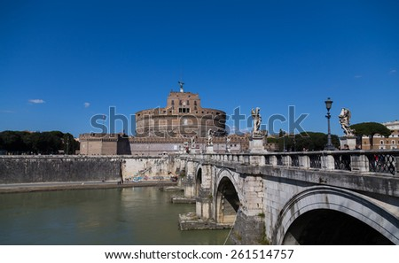 ROME, ITALY - 12TH MARCH 2015: Castel Sant'Angelo (Castle of the Holy Angel) and the Ponte Sant'Angelo bridge from the side. People can be seen around the building and on the bridge - stock photo