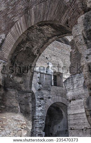ROME - January 7: Colosseum (Coliseum) on January 7, 2014 Rome, Italy. The Colosseum is an important monument of antiquity and is one of the main tourist attractions of Rome. - stock photo