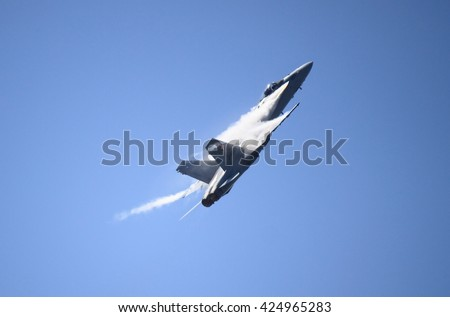 ROME - JUNE 28: A F-18 Hornet of the Swiss Air Force performs at the Rome International Air Show on June 28, 2014 in Rome, Italy - stock photo