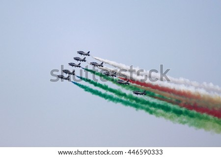 ROME - JUNE 29: The italian acrobatic team Frecce Tricolori perform at the Rome International Air Show on June 29, 2014 in Rome, Italy - stock photo