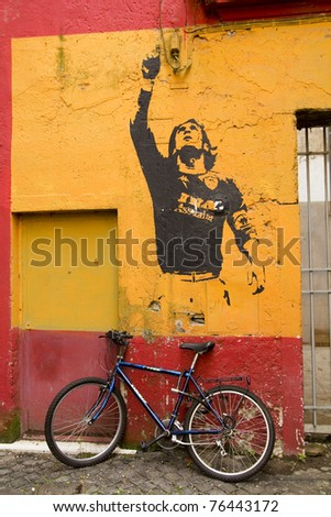 ROME - MARCH 19: Mural in honor of Argintine Futbol Club player Lionel Messi by graffiti artist Banksy shown on March 19, 2011 in Rome, Italy. - stock photo