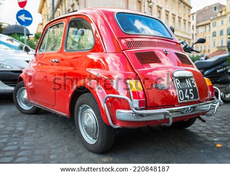 ROME - OCTOBER 20: Red Fiat 500 parked on October 20, 2013 in Rome. Italy - stock photo