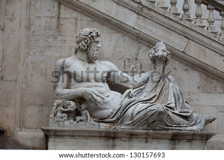 Rome - Sculpture of Tiber river in the Capitolium planed by Michelangelo. - stock photo