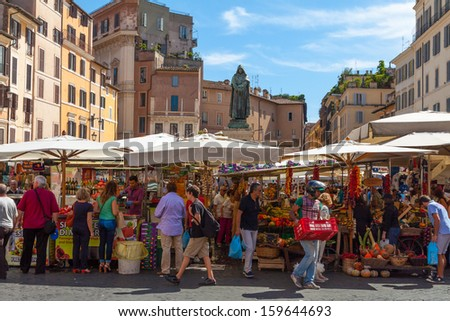 Rome - SEP 21: Campo de 'Fiori, September 21,2013 in Rome, Italy. Field of Flowers is one of the main squares of Rome, lively both day, market, and at night, when the terraces are filled with tourists - stock photo