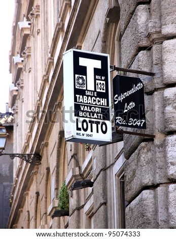 ROME - SEPTEMBER 17: A tobacco shop sign on September 17, 2011 in Rome. Italian licensed sellers must expose this sign outside the shop. - stock photo