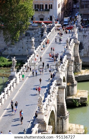 ROME - SEPTEMBER 13: Castel Sant'Angelo on September 13, 2011 in Rome. The bridge is now solely pedestrian, and provides a photogenic vista of the Castel Sant'Angelo. - stock photo