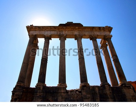 ROME - SEPTEMBER 17: The Roman Forum area on September 17, 2011 in Rome. The Temple of Saturn is a temple to the god Saturn in ancient Rome and is dated 497 BC. - stock photo