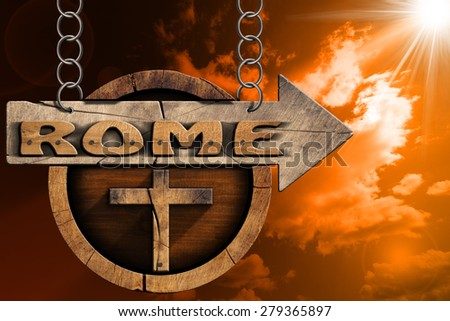 Rome - Sign with Cross at Sunset. Pilgrimage wooden directional sign of Rome with an arrow and religious cross. Hanging from a metal chain at sunset with clouds and sun rays - stock photo