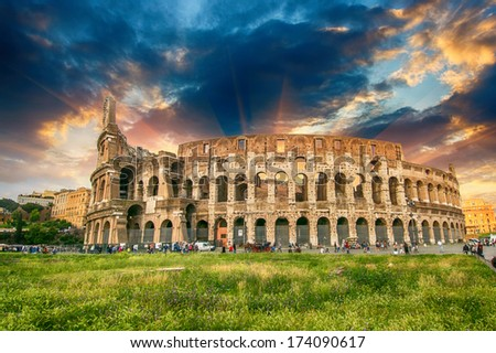 Rome, The Colosseum. Beautiful view with colorful spring sky. Roma, Il Colosseo. - stock photo