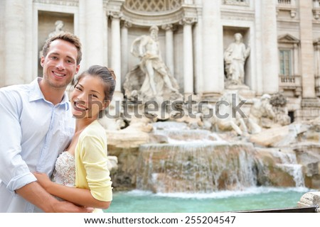 Rome travel - tourist couple on travel by Trevi Fountain in Rome, Italy. Happy young romantic couple traveling in Europe taking self-portrait with smartphone camera. Man and woman happy together - stock photo