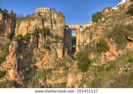 Ronda is a city in the Spanish province of M���¡laga.Puente Nuevo is the tallest of the Ronda bridges, towering 120 metres (390 ft) above the canyon floor. - stock photo