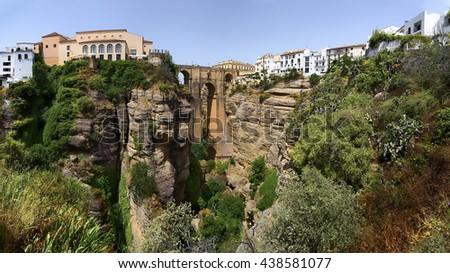 Ronda, Spain at the Puente Nuevo Bridge over the Tajo Gorge- panorama - stock photo