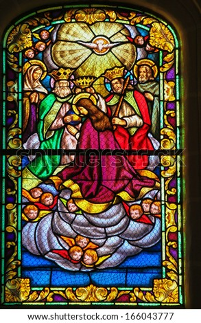 RONDA, SPAIN - DEC 1: Stained glass window depicting the Assumption of the Virgin Mary, in the church of Ronda, Spain, on December 1, 2013.  - stock photo