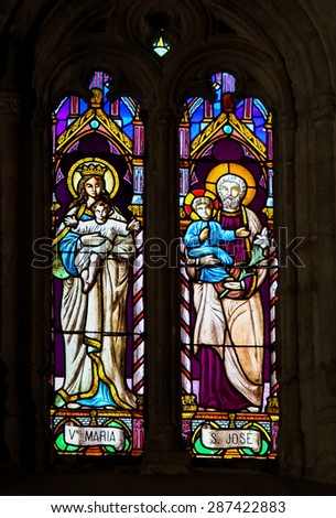RONDA, SPAIN - DECEMBER 1, 2013: Stained Glass depicting Mother Mary and Saint Joseph, Jesus' parents, in the Church of Ronda, Spain - stock photo