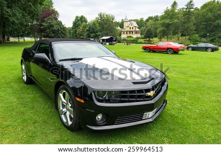 "RONNEBY, SWEDEN - AUGUST 09: Summer V8 car fans event ""Pony & muscle car meet"". Front view of Corvette Stingray C7 in 08 August, 2014 in Ronneby, Sweden. - stock photo"