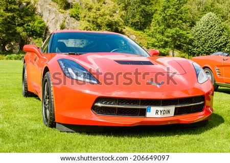 "RONNEBY, SWEDEN - JULY 17, 2014: Press show for upcoming event ""Pony and muscle car meet"". Front and side view of Corvette Stingray C7 2014. - stock photo"