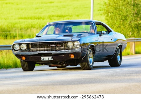 RONNEBY, SWEDEN - JUNE 26, 2015: Veteran car street cruise on public roads. Dodge challenger 1970 black - stock photo