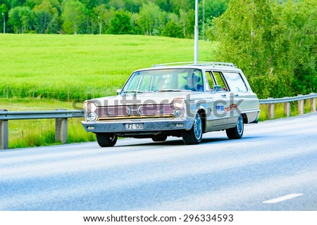 RONNEBY, SWEDEN - JUNE 26, 2015: Veteran car street cruise on public roads. Plymouth fury II brown 1966. - stock photo