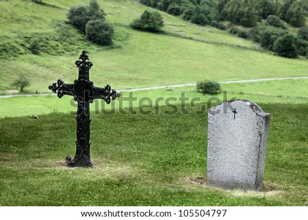 Rood and headstone in Norway Cemetery. Two graves in quiet landscape. - stock photo