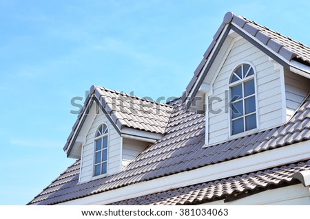 roof and blue sky - stock photo