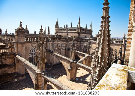 Roof and spires of the Saint Mary cathedral in Seville, Spain. - stock photo