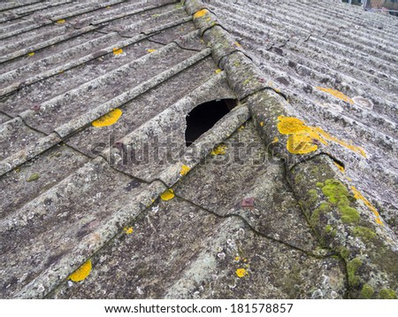 roof covered with asbestos and concrete panels - stock photo