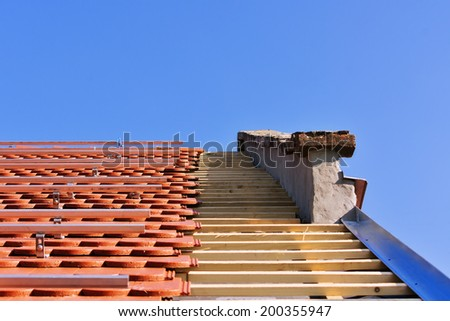 Roof detail with installed solar construction frames - stock photo