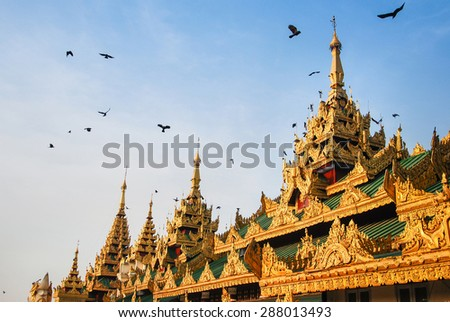 Roof of building in front of Shwedagon Pagoda, famous attraction in Myanmar (Burma). This detail is Burmese architecture style. - stock photo