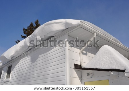Roof of the house with snow - stock photo