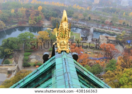 Roof ornament at Osaka Castle in the form of shachi-an animal from Japanese folklore,a mythological creature with the body of a carp and the head of a lion or tiger,believed to protect against fire.  - stock photo