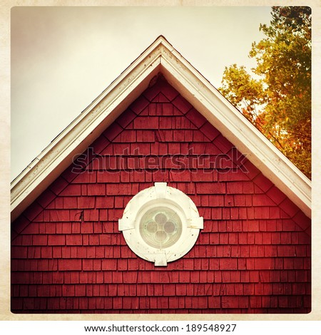 Roof point of an old red building in New England, instagram style - stock photo