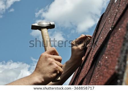 Roof repairs - stock photo