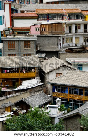 roof tops in Zhongdian China, traditional cultural buildings - stock photo