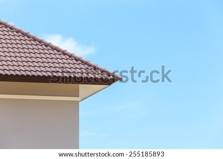 roof under construction with stacks of roof tiles for home building  - stock photo