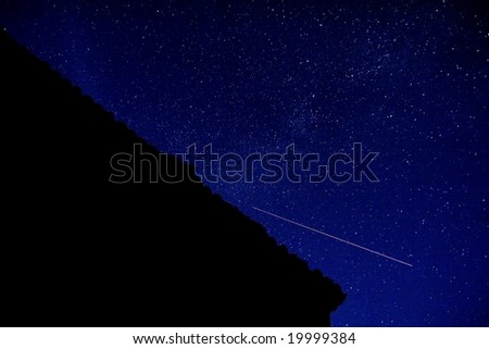 roof under the stars - stock photo