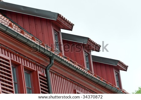 Roof with ceramic tiles intensyve dark red colour - stock photo