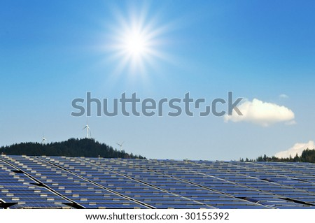 roof with solar installation and sun - stock photo