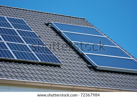 Roof with solar panel fragments - stock photo