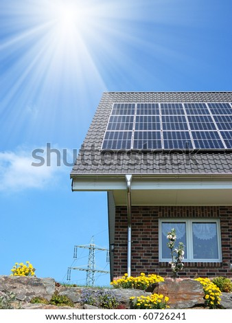 Roof with solar panel under cloudy sky - stock photo
